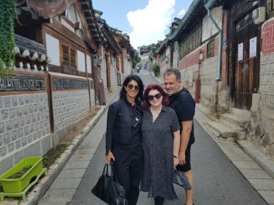 Three people on our Bukchon Hanok Village tour posing stopping for a photo