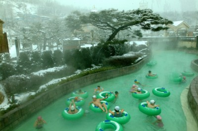 People at Caribbean Bay in winter riding the tubes in heated water