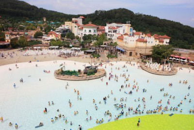 Caribbean Bay's giant outdoor wave pool fulled with children and adults in summer