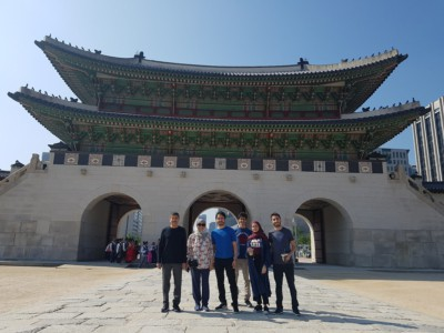 A family on our Gyeongbok Palace tour taking a photo in front of Gwanghwamun gate