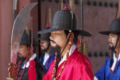 Gyeongbokgung royal palace guards performing their duty during the changing of the guard ceremony