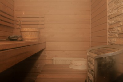 Inside an empty sauna filled with steam