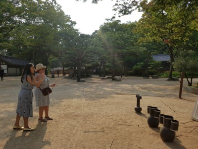Mother and daughter playing a traditional folk game at a Folk Village in Yongin