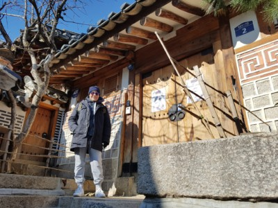Posing for a photo outside a beautiful traditional style hanok house