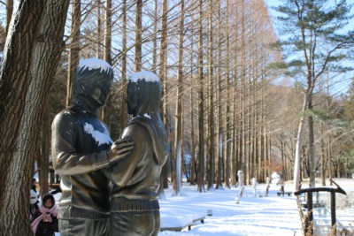 The Winter Sonata statue in Gongsaengwon Garden on Nami Island covered in snow during winter