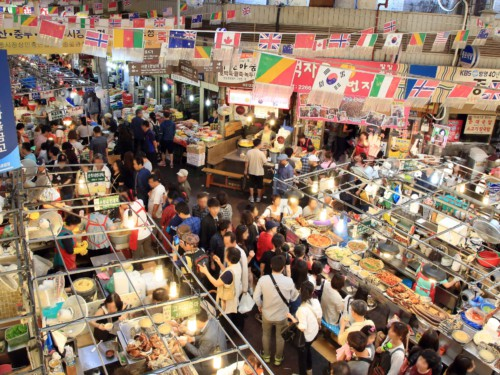 People queuing up for food at the busy Gwangjang Market in Seoul