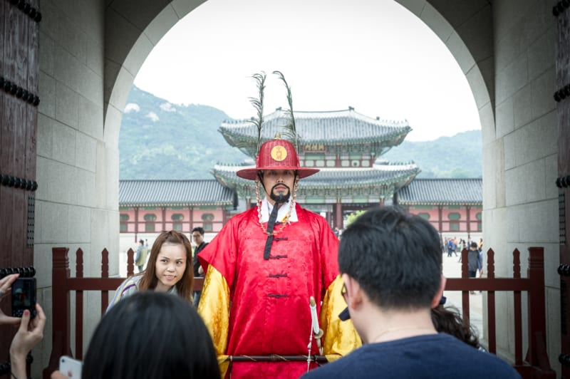 Taking a picture with a Gyeongbokgung Palace guard
