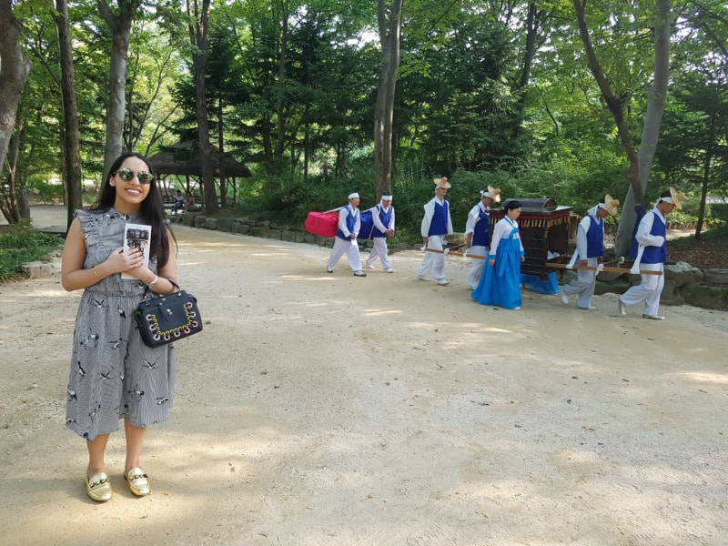 Watching traditional style royal transport at the Korean Folk Village in Yongin