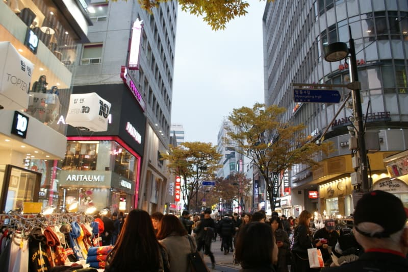 People shopping at Myeongdong shopping street in Seoul