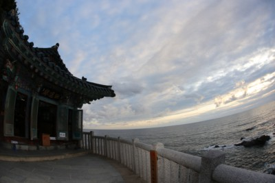 Naksansa temple sitting in front of the sea on a cloudy day