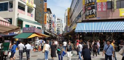 in the middle of busy Namdaemun market watching people pass by