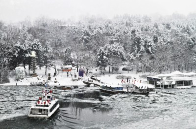 The Nami Island ferry docking at Nami Island Wharf in Winter with icy water and snow covered trees