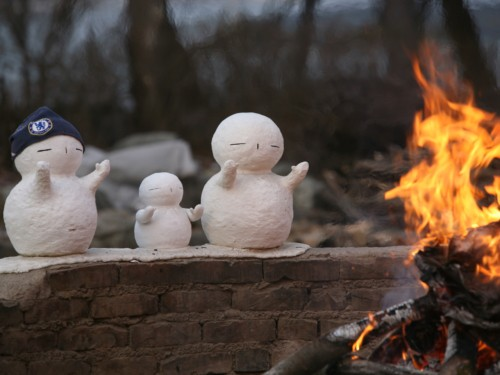 Snowmen enjoying the warm fire at Nami Island in Winter