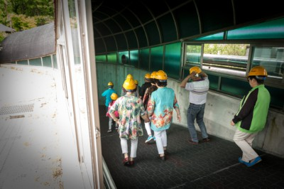 A group of people on our half day DMZ tour entering the 3rd Infiltration Tunnel