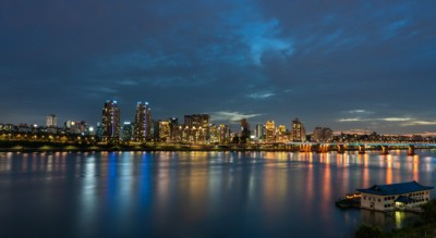 A tranquil night view of the Han River with bright lights glowing off the water