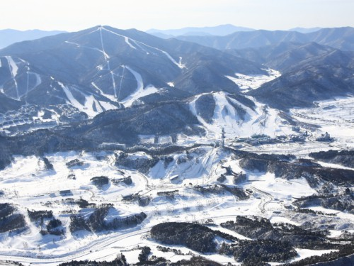 An aerial view of Alpensia Ski Resort covered in snow