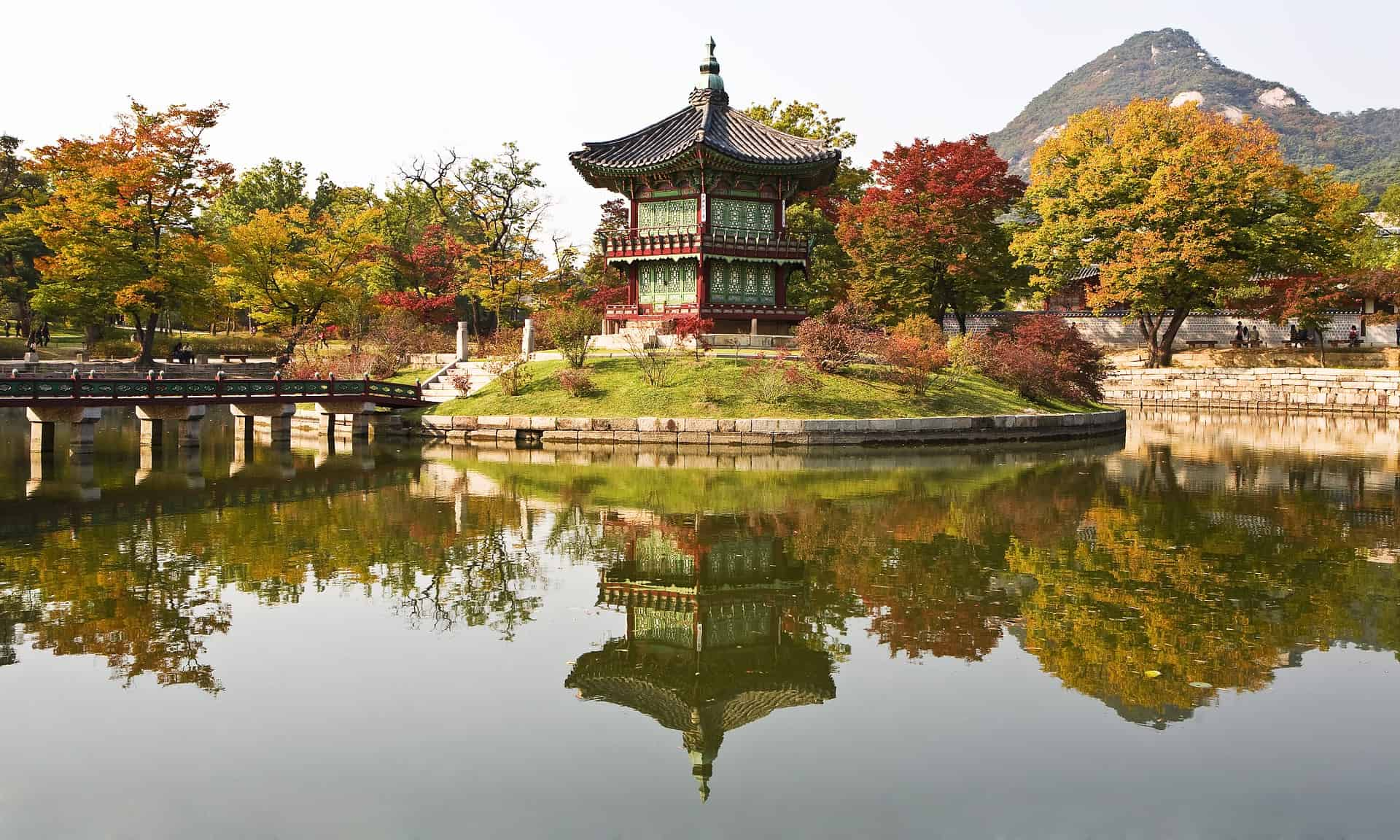 Gorgeous Hyangwonjeong Pavilion surrounded by a pond and beautiful red and yellow leaves during autumn in Korea
