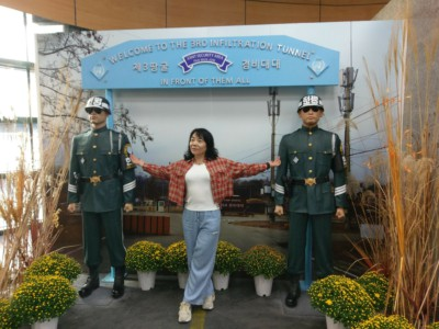 Someone posing in front of a sign at the Third Tunnel of Aggression on one of our DMZ tours from Seoul